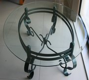 Oval glass topped powder coated green wrought iron table