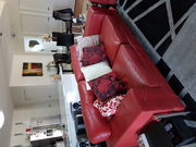 TWO RED LEATHER SOFA'S
