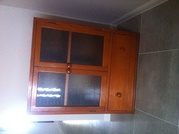 Timber cupboard with two glass doors. $50.00